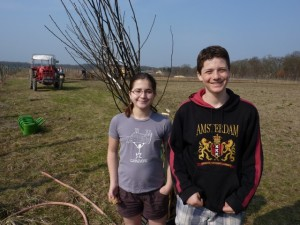Olivia and Avery Swarthout take a break from planting a pear tree. Credit: Brian Swarthout, March, 2012.